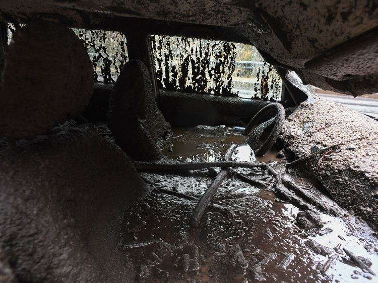Mud fills the interior of a car destroyed in a rain-driven mudslide in a neighbourhood under mandatory evacuation in Burbank, California, January 9, 2018