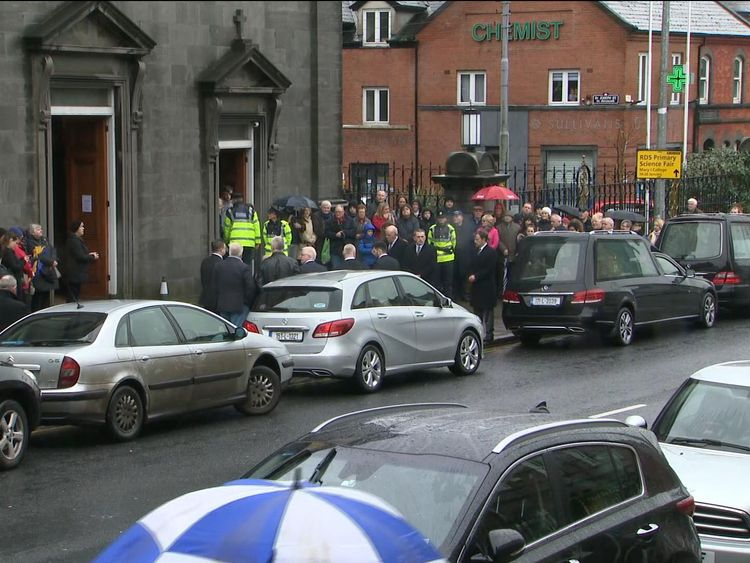 Fans gathered outside as the hearse arrives