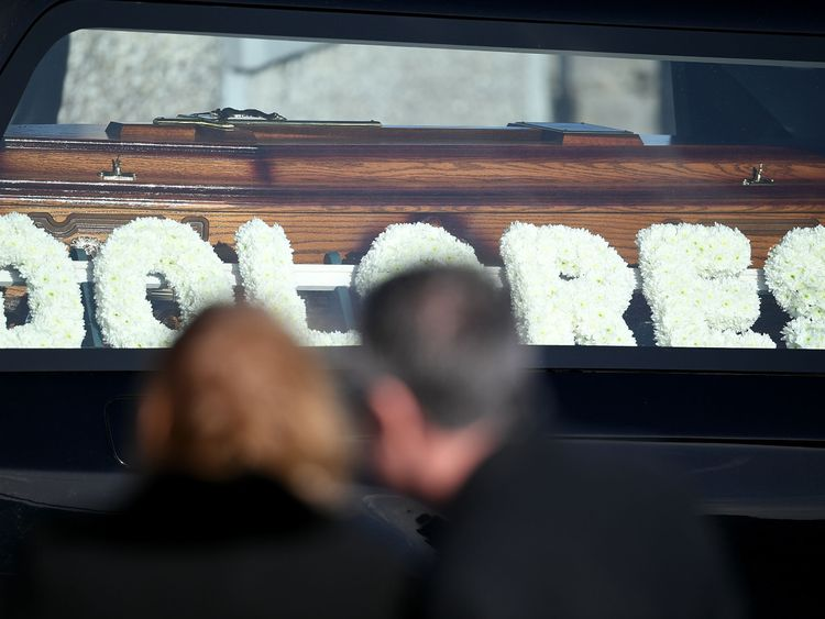 Flowers spelling the name 'Dolores' rest next to the coffin at the funeral of Dolores O'Riordan at St Ailbe's parish church in Ballybricken on January 23, 2018 in Limerick, Ireland. The Cranberries singer, aged 46 was found unresponsive in a London hotel last week.