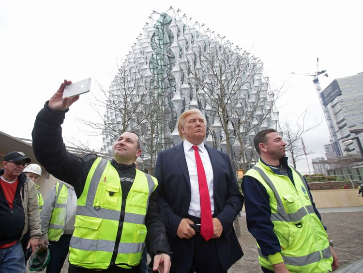 The Madame Tussauds polish figure of US President Donald Trump outward the new US Embassy in Nine Elms, London, after Mr Trump reliable he will not transport to the UK to open the new building - and hit out at the plcae of the 1.2 billion dollar (886 million) project.