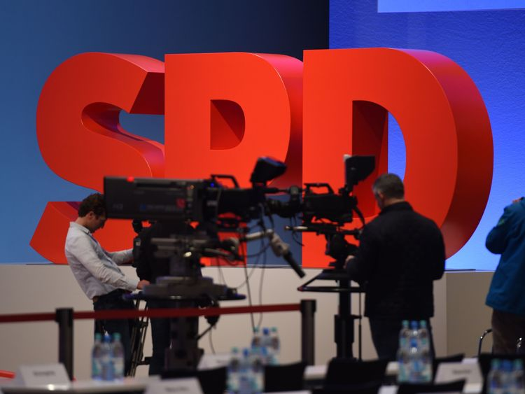 Cameramen film the logo of Germany's social democratic SPD party at the venue of an SPD party congress o