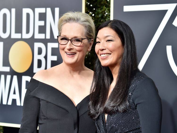 Meryl Street arrives at the Golden Globes with women's activist Ai-jen Poo