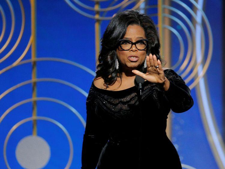 Oprah Winfrey collects her lifetime achievement award