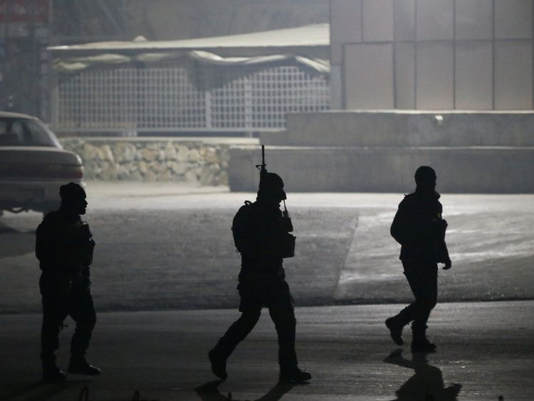 Afghan security forces arrive the site of an attack on the Intercontinental Hotel in Kabul