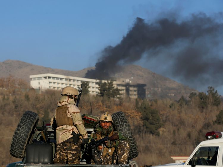 Afghan security forces keep watch as smoke rises from the Intercontinental Hotel in Kabul, Afghanistan January 21, 2018