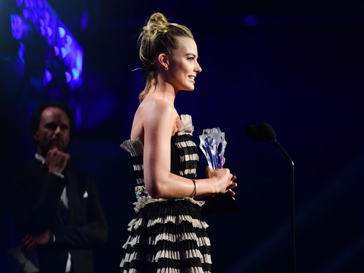 Actor Margot Robbie accepts Best Actress in a Comedy for 'I, Tonya' onstage during The 23rd Annual Critics' Choice Awards at Barker Hangar on January 11, 2018 in Santa Monica, California. (Photo by Matt Winkelmeyer/Getty Images for The Critics' Choice Awards )