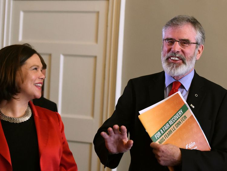 Sinn Fein leader Gerry Adams laughs as Mary Lou Mc Donald watches after a pre-election news conference in Dublin Ireland