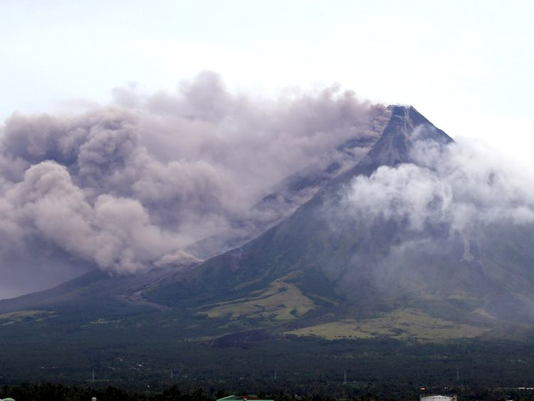 The Mayon volcano spews a column of ash in Legazpi City, Albay province, south of Manila, Philippines
