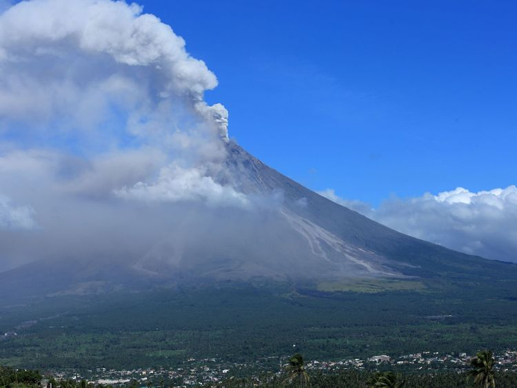 Ash spews from the Mayon volcano as it continues to erupt