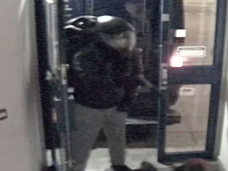 The moment a suspect held a bank security at gun-point Pic: Met Police