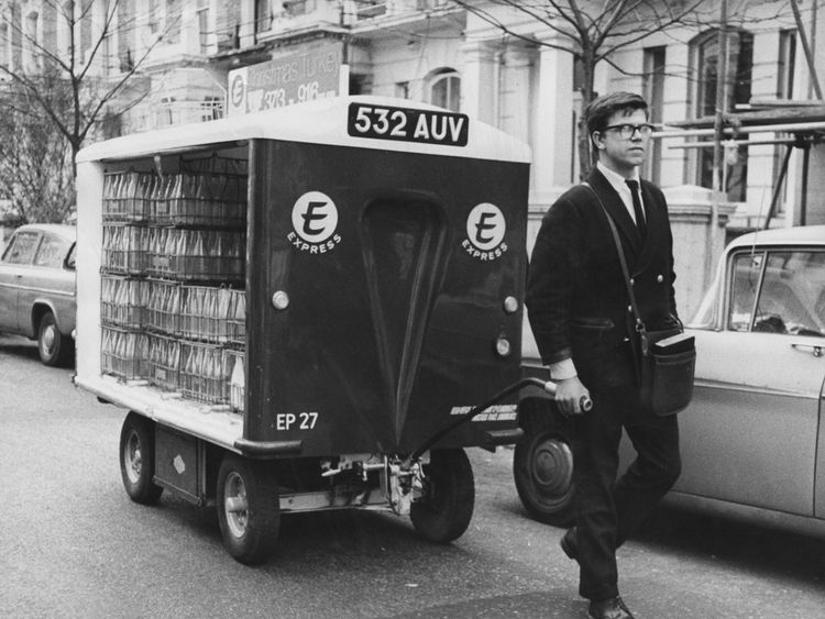 A milkman doing his rounds with a hand-pulled float in 1966