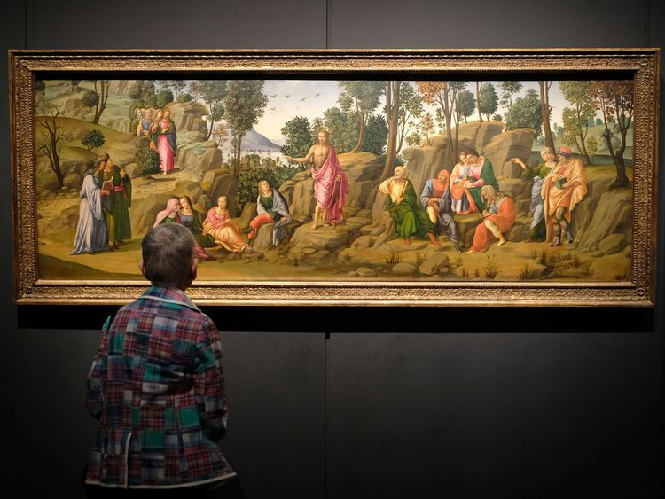 A visitor admires a Michaelangelo painting at the New York Met