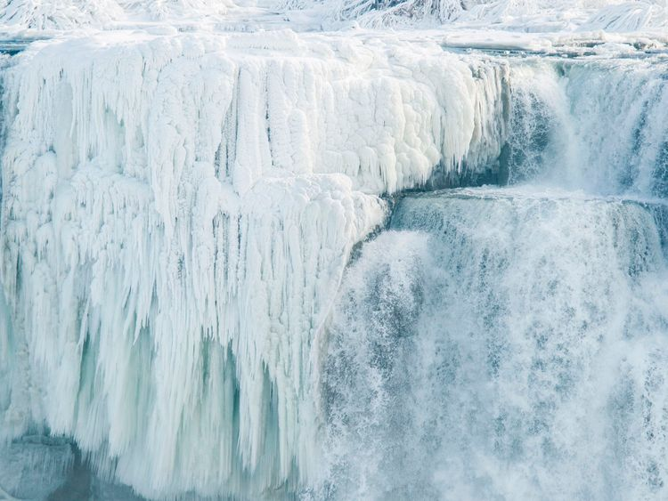 Ice hangs from the top of the American side of Niagara Falls on January 3, 2018