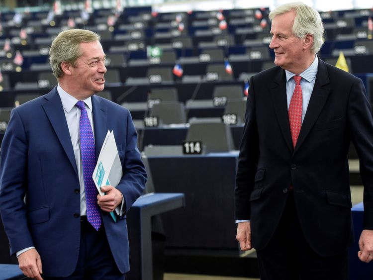 Michel Barnier speaks with MEP and former UKIP leader Nigel Farage at the European Parliament