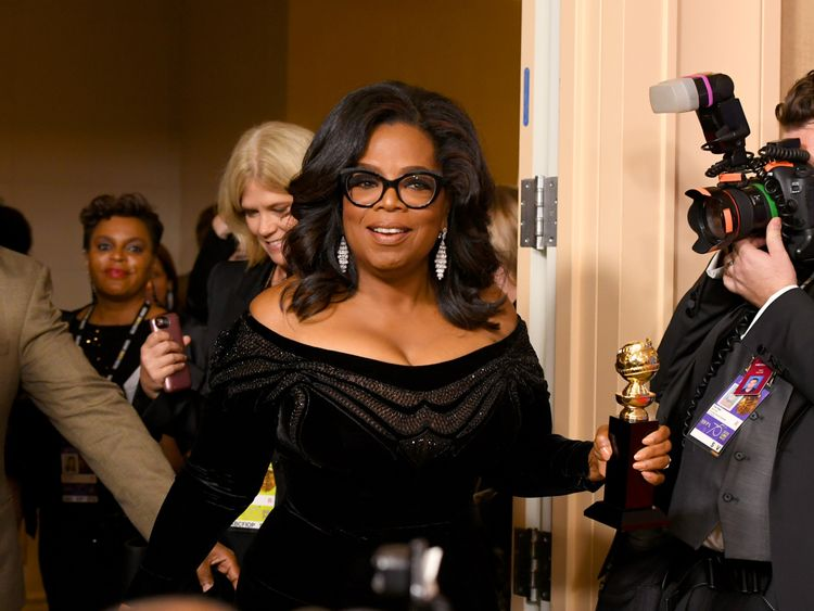 Oprah Winfrey arrives in the Golden Globes press room