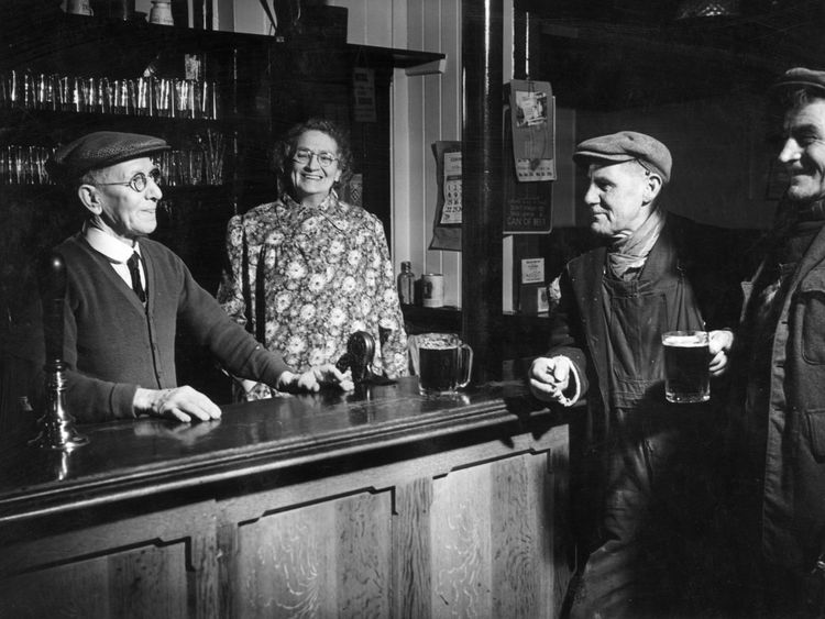 The regulars and bar staff at a open residence in Windlesham, Surrey in 1957