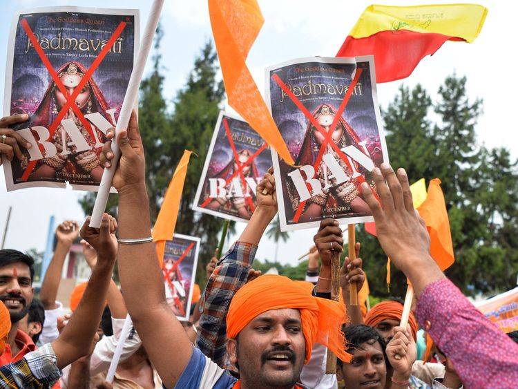Members and activists of the Karnataka wing of Rashtriya Rajput Karni Sena caste organisation hold posters demanding the ban on screening of Bollywood movie 'Padmavathi', in Bangalore on November 15, 2017. The activists alleged that the movie directed by Sanjay Leela Bhansali at a cost of 1900 million Indian rupees distorts the historical facts. / AFP PHOTO / MANJUNATH KIRAN (Photo credit should read MANJUNATH KIRAN/AFP/Getty Images)