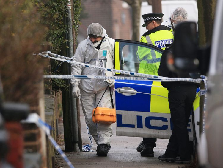A forensics officer at the scene of an investigation at Matlock Road in Reddish
