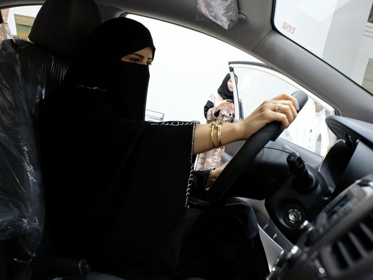 A woman sits behind the wheel at the show in Jeddah