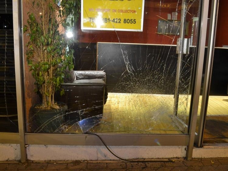 The smashed window of the Spicy Night restaurant
