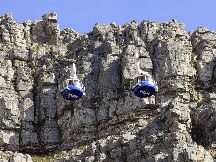 Rescue workers abseiled from a cable car to rescue the survivor