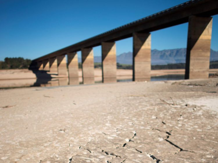 A picture taken on May 10, 2017 shows dry cracked mud staring out at the sky at Theewaterskloof Dam, which has less than 20% of it's water capacity, near Villiersdorp, about 108Km from Cape Town