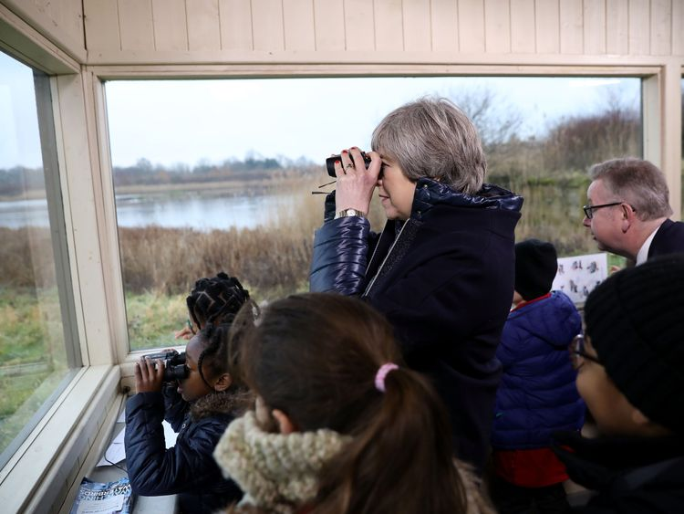 Theresa May watches birds from inside a bird censor with school children at the London Wetland Centre in Barnes