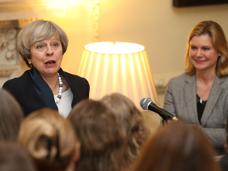Theresa May alongside Justine Greening