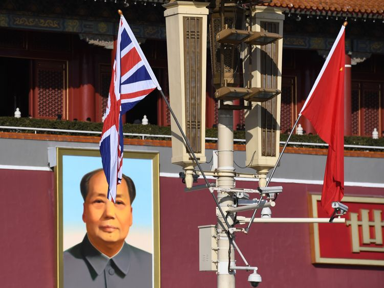 The British and Chinese flags fly near the portrait of late communist leader Mao Zedong on Tiananmen Gate ahead of a welcoming ceremony for Britain's Prime Minister Theresa May in Beijing on January 31, 2018
