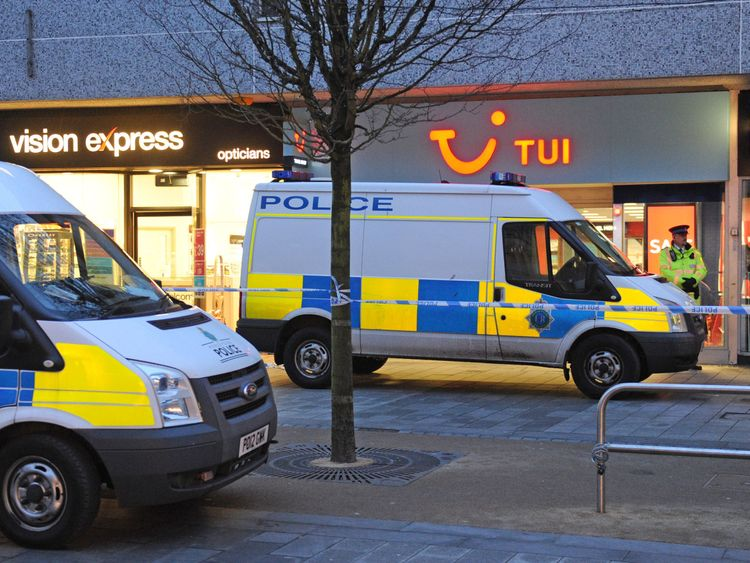 The area around the Tui travel agents remains cordoned off