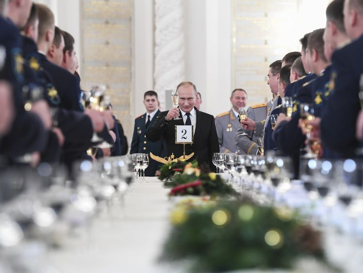 Russian President Vladimir Putin toasts with attendees after a state awards ceremony for military personnel who served in Syria, at the Kremlin in Moscow, Russia December 28, 2017
