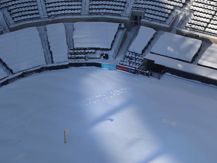 A pair of footprints are seen through a blanket of snow in Yankees Stadium on January 5, 2018 in the Bronx Borough of New York City