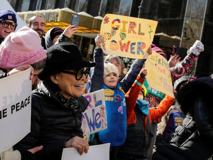 Artist Yoko Ono (L) takes part in the Women's March in Manhattan in New York City, New York, U.S., January 20, 2018. REUTERS/Eduardo Munoz