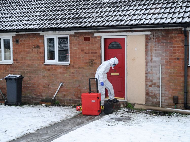 A police forensics officer at the property in Brownhills