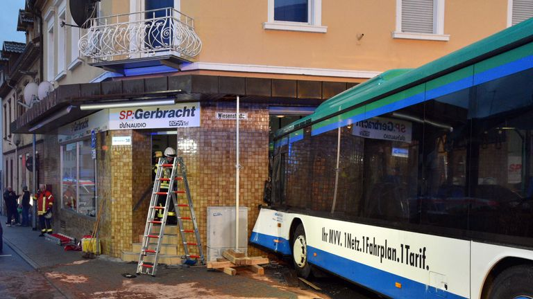 Germany school bus crash into shop