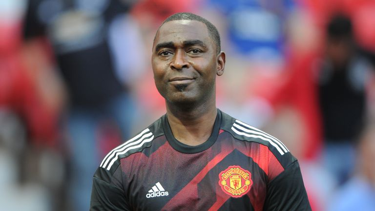 Andrew Cole wearing a Manchester United shirt during a legends game against Barcelona at Old Trafford