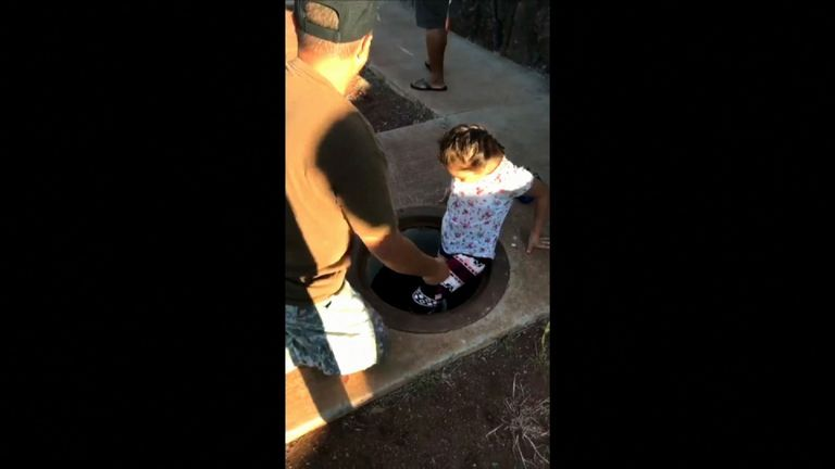 Worried father tells daughter to shelter in manhole. Pic: Instagram/@joshuua
