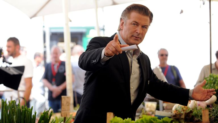 US actor Alec Baldwin (L) gestures while on the set of US film director Woody Allen's latest production, 'Bop Decameron', at Campo de' Fiori square in central Rome, on July 28, 2011. The film's crew has been spotted everywhere from the Spanish Steps to the Colosseum to Rome's main shopping avenue, Via del Corso, and paparazzi have been kept busy chasing stars Alec Baldwin and Penelope Cruz. AFP PHOTO / TIZIANA FABI (Photo credit should read TIZIANA FABI/AFP/Getty Images)
