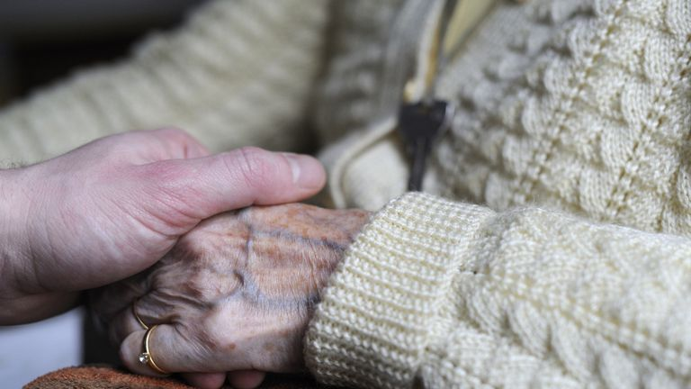 A woman, suffering from Alzheimer's desease, holds the hand of a relative on March 18, 2011 in a retirement house in Angervilliers, eastern France. AFP PHOTO / SEBASTIEN BOZON (Photo credit should read SEBASTIEN BOZON/AFP/Getty Images)