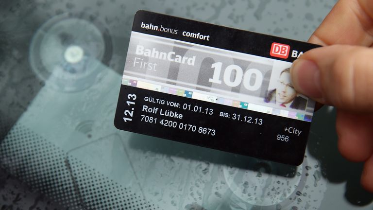 BERLIN, GERMANY - OCTOBER 28: Rolf Luebke, Chairman of Deutsche Bahn Mobility Networks Logistics, which owns car-sharing provider Flinkster, demonstrates the use of a BahnCard 100 customer account card in accessing a Flinkster car on October 28, 2013 in Berlin, Germany. Flinkster is one of several car-sharing companies that have emerged in a growing market in Germany in the last several years.