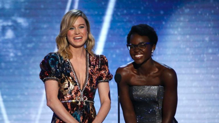 Actresses Brie Larson and Lupita Nyong'o present the award for Outstanding Performance by a Cast in a Motion Picture.