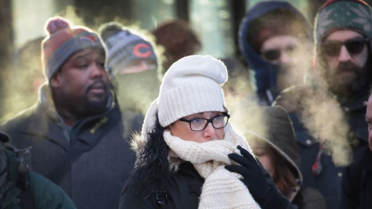 People in Chicago braved another freezing walk to work on Tuesday