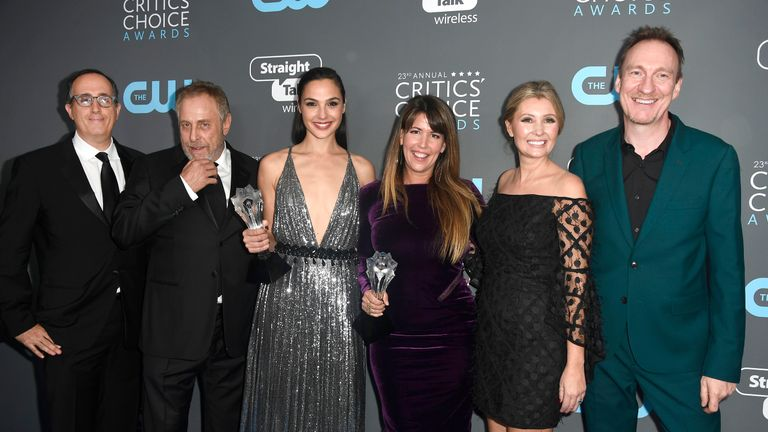 Producers Richard Suckle and Charles Roven, actor Gal Gadot, director Patty Jenkins, Connie Nielsen and David Thewlis, recipients of the Best Action Movie award for 'Wonder Woman', pose in the press room during The 23rd Annual Critics' Choice Awards at Barker Hangar on January 11, 2018 in Santa Monica, California. (Photo by Frazer Harrison/Getty Images)
