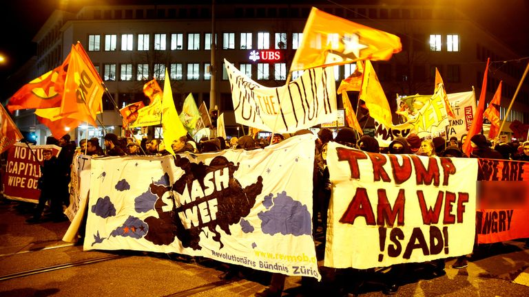 Protesters carry banners during a demonstration against U.S. President Donald Trump in Zurich