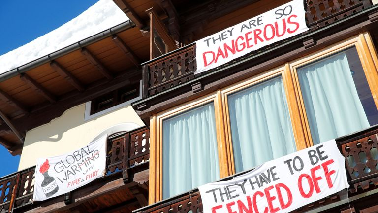 Banners against WEF are pictured close to the Congress Centre during the World Economic Forum annual meeting in Davos