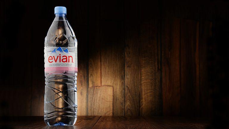 A plastic Evian water bottle