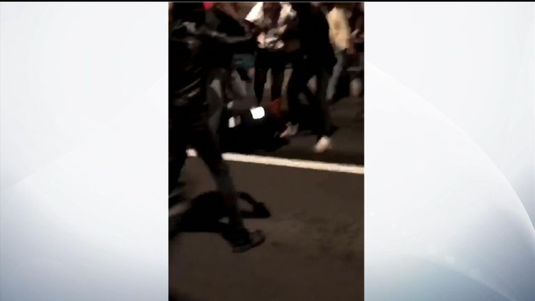 The female officer is kicked and stamped on by numerous people