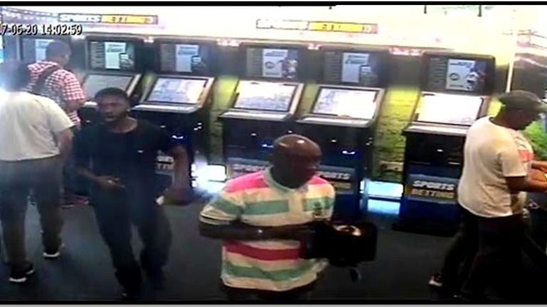 The men were caught on CCTV trading in a betting shop