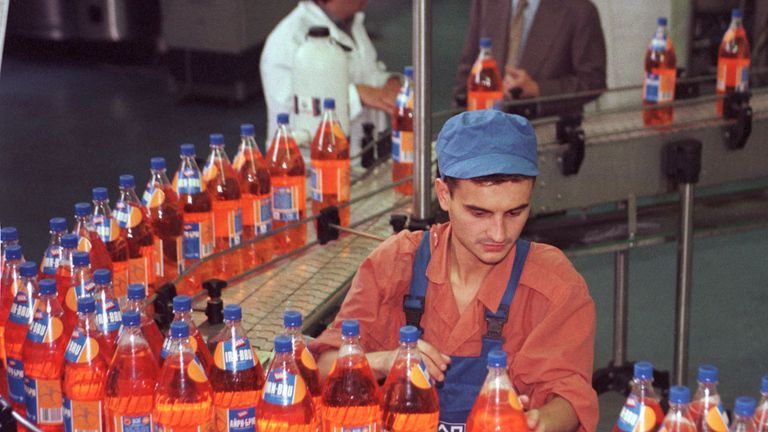 An Irn Bru worker on the drink's 1990s production line