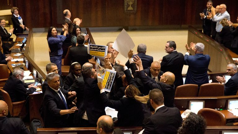 """Arab Israeli MPs held signs saying  """"Jerusalem is the capital of Palestine"""" during Mike Pence's speech"""